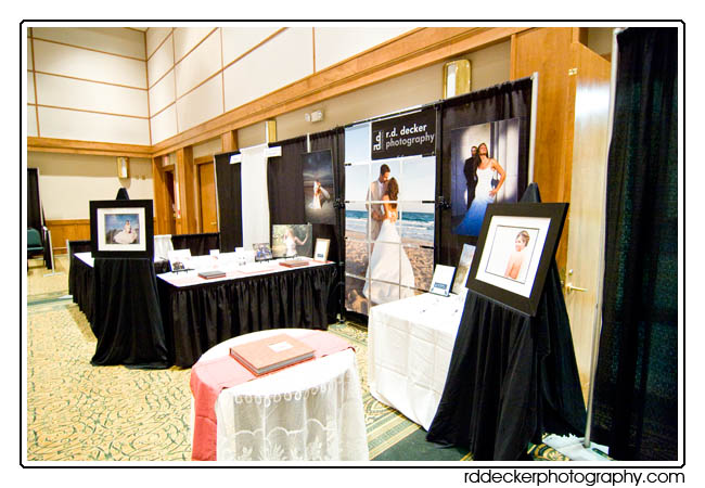 R. D. Decker Photography bridal show booth featured a 7' tall photo-mosaic of a romantic newly wed couple on the beach at Pine Knoll Shores